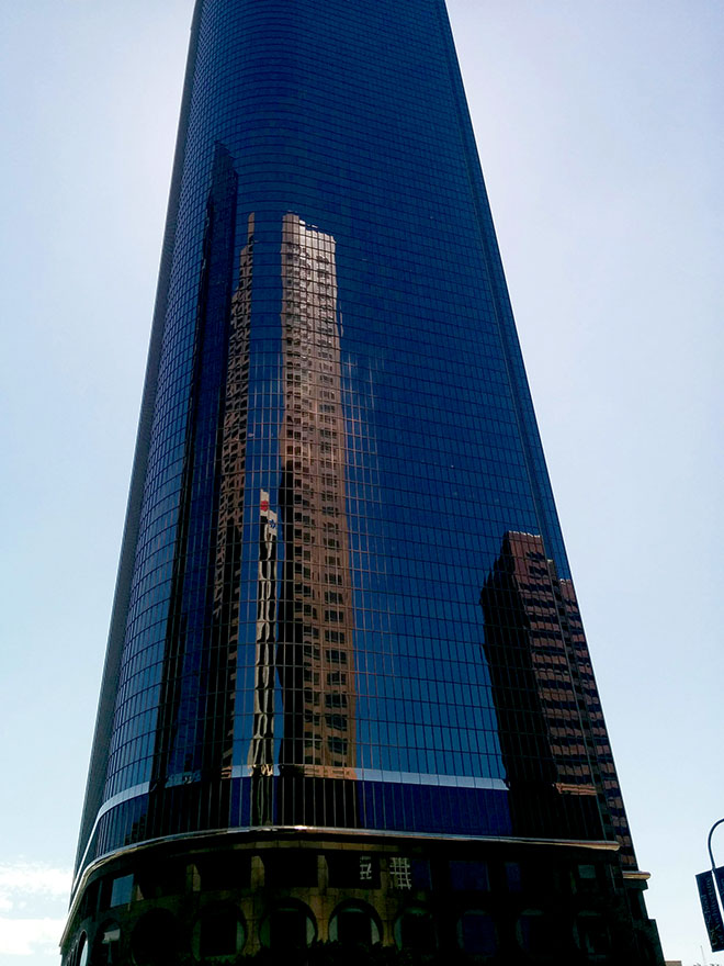 Single glass building in downtown Los Angeles photographed by advertising photographer, John Ussenko.