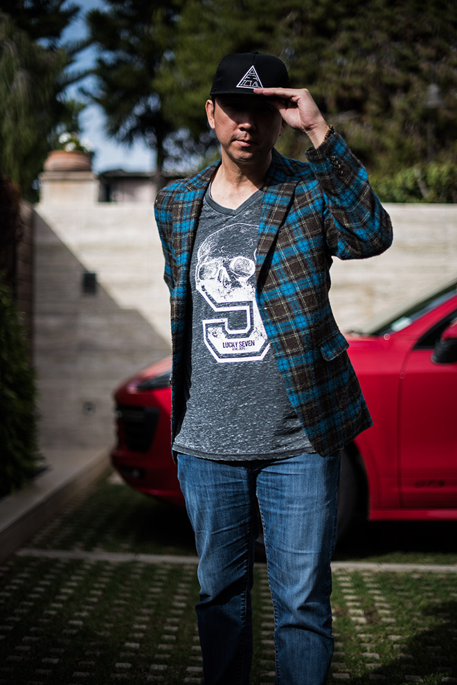 Fashion shoot in Laguna Beach with Simon Spurr plaid blue sport coat, Mavi Jeans, and Crown of Laurel snapback, with fashion and lifestyle photographer, John Ussenko.