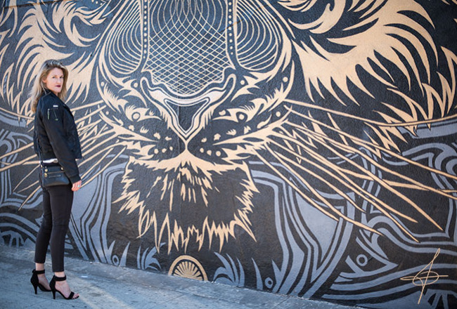 Fashion photographer John Ussenko at the Chris Saunders Tiger Mural in Santa Monica.