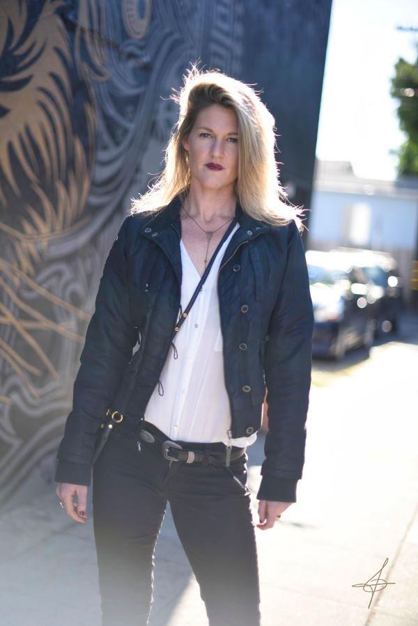 Fashion photog John Ussenko at the Chris Saunders Tiger Mural in Santa Monica.