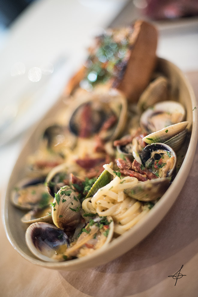 Clams with linguini pasta at Cucina Enoteca by lifestyle photographer, John Ussenko on location in Irvine, Orange County.