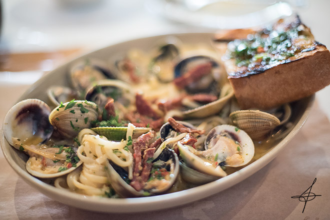 Clams with linguini pasta at Cucina Enoteca by lifestyle photographer, John Ussenko on location in Irvine Specturm in Orange County.