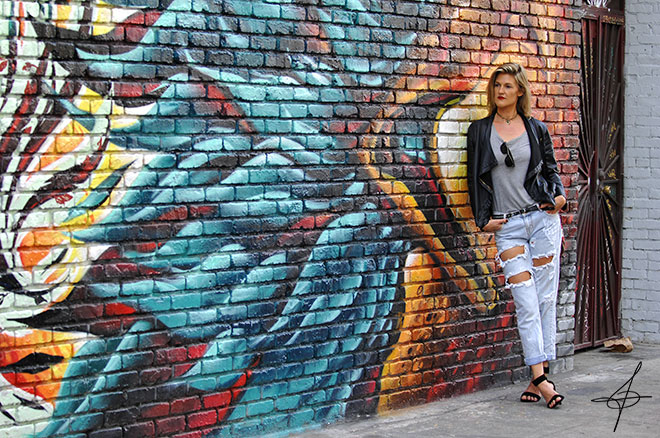 Black leather jacket fashion shoot and the hawk wall in downtown los angeles by lifestyle photographer, John Ussenko and model Janelle Carroll.