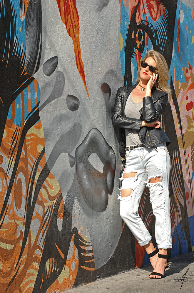 Black leather jacket fashion shoot and graffiti of face in downtown LA with street fashion photographer John Ussenko and model Janelle Carroll.