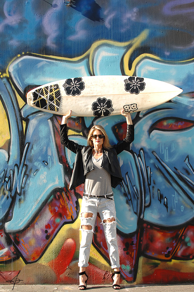Fashion shoot with a surfboard in downtown los angeles with lifestyle photographer, John Ussenko and model Janelle Carroll.