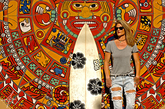 Fashion shoot with aztec mural and surfboard in downtown los angeles with lifestyle photographer, John Ussenko and model Janelle Carroll.
