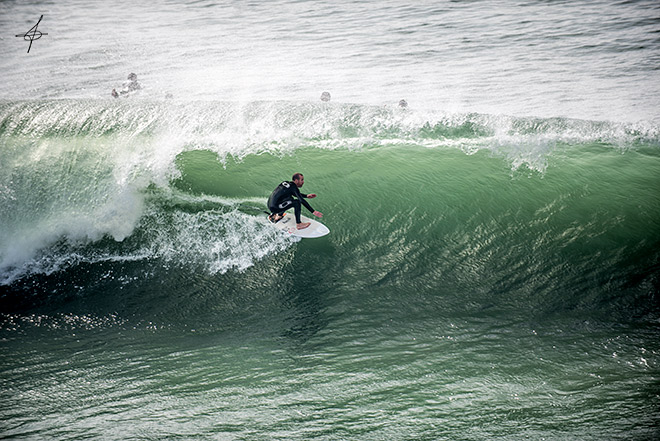 Lifestyle photographer, John Ussenko captures a surfer in a barrel at the Huntington beach pier during a 10-12ft swell.