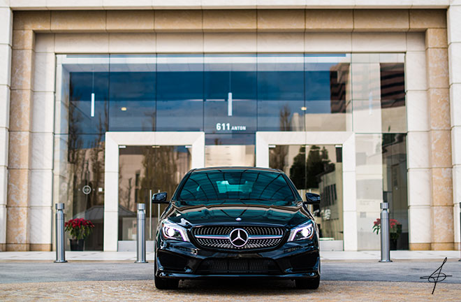 Front of a Mercedes Benz for a lifestyle photo shoot with edgy street lifestyle photographer John Ussenko.