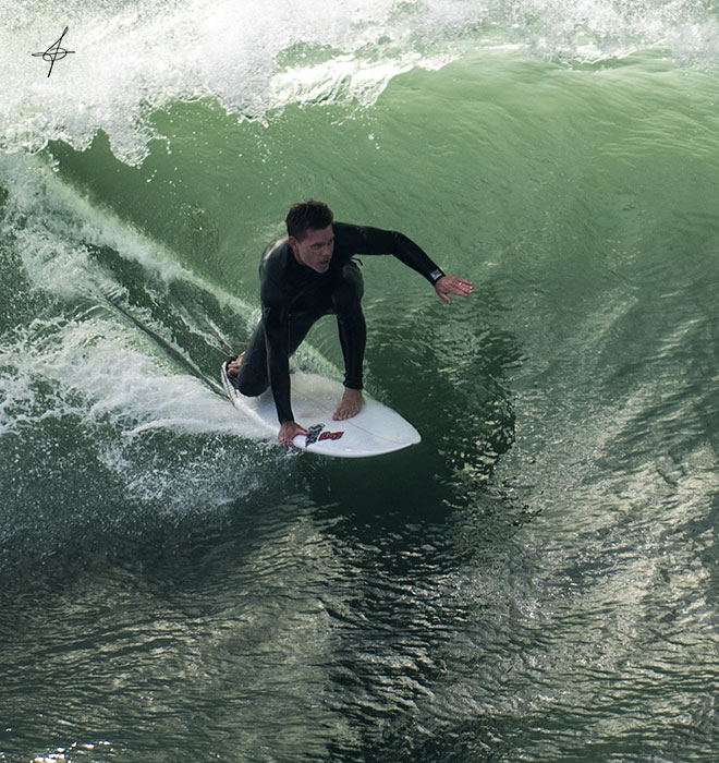 Close photo of surfer in barrel in Huntington Beach.