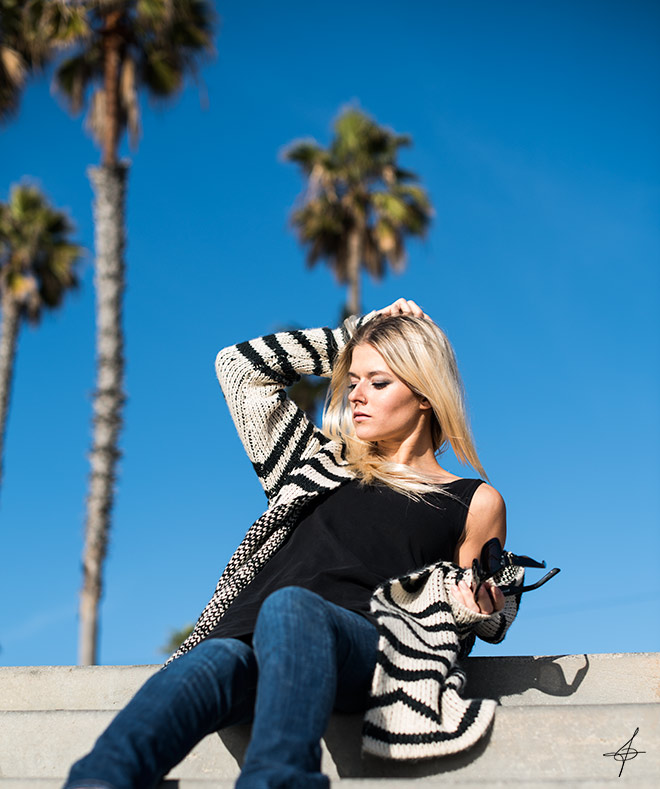 Roxy sponsored pro snowboarder, Alyona Elena Alekhina doing a photo shoot with a Roxy Cardigan. Street fashion photographer, John Ussenko on location in Sunset Beach stairs.